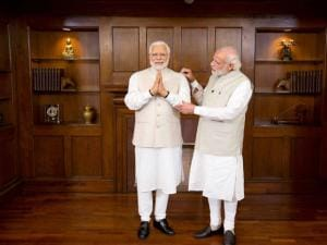 Prime Minster Narendra Modi stands next to his wax statue due to be placed at London's Madame Tussauds