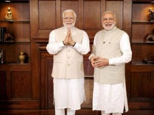 Prime Minster Narendra Modi stands next to his wax statue due to be placed at London's Madame Tussauds museum