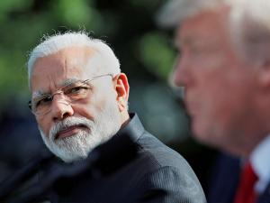 Prime Minister Narendra Modi looks toward President Donald Trump