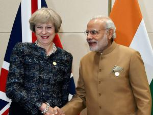 Narendra Modi shakes hands with  UK Prime Minister Theresa May