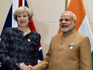Prime Minister Narendra Modi shakes hands with   Theresa May
