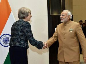 Prime Minister Narendra Modi shakes hands with  UK Prime Minister Theresa May