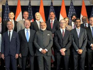 Prime Minister, Narendra Modi pose for a group photograph with  US business leaders
