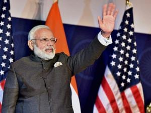 Prime Minister Narendra Modi waves during the United States Community Reception
