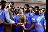 Mos Rajyavardhan Singh Rathore poses with the Blind Cricket Team