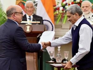 Indian defence Minister Manohar Parrikar exchanges documents with his Portugal counterpart as Prime Minister Narendra Modi and his Portugal counterpart Antonio Costa