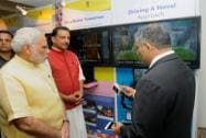 Prime Minister Narendra Modi visiting an exhibition at the launch of the National Skill Development Mission