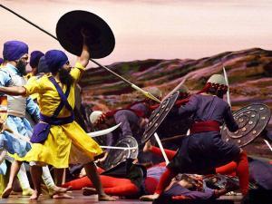 Artists perform a play during the Banda Singh Bahadur's 300th martyrdom function