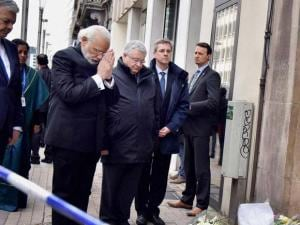 Prime Minister Narendra Modi paying_homage to the victims of the recent terror attack at the Maelbeek Metro Station in Brussels, Belgium