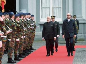 Prime Minister Narendra Modi reviews a guard of honor along with his Belgian counterpart Charles Michael at a ceremonial welcome at the Egmont Palace in Brussels