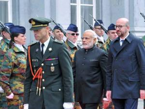 Prime Minister Narendra Modi reviews a guard of honor along with his Belgian counterpart Charles Michel at_a ceremonial welcome at the Egmont Palace in Brussels