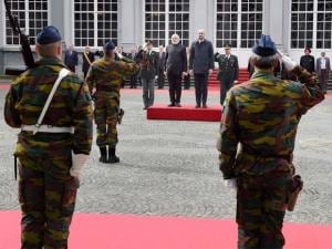Prime Minister Narendra Modi reviews a guard of honor along with his Belgian counterpart Charles Michel at a ceremonial welcome at the Egmont Palace in Brussels