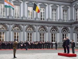 Prime Minister Narendra Modi reviews a guard_of honor along with his Belgian counterpart Charles Michel at a ceremonial welcome at the Egmont Palace in Brussels