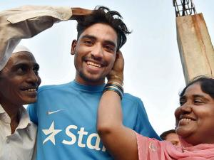 Mohammed Siraj with father Md Ghouse and mother Shabana Begum at his residence in Hyderabad