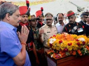 Defence Minister Manohar Parrikar pay tributes at the mortal remains of Colonel Santosh Mahadik