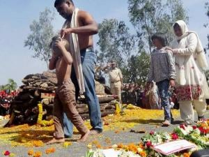 The wife and children of Colonel Santosh Y Mahadik during his cremation in Satara