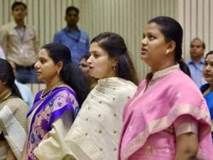 TRS (MP) K Kavitha (3rd L) along with other  legislators stand for the national anthem during the inaugural session of the National Conference of Women Legislators