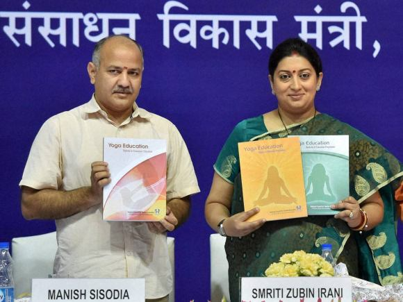 NCERT Book, Yoga, Smriti Irani, Manish Sisodia, Teachers Conference, National Yoga Teachers Conference