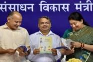 HRD Minister Smriti Irani with Delhi Dy CM Manish Sisodia while releasing books on Yoga