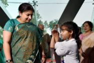 Smriti Irani is welcomed by a girl with a Yogasana