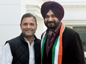 Congress Vice-President Rahul Gandhi welcomes former BJP leader Navjot Singh Sidhu into the party at his residence