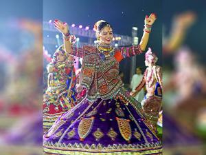 A woman in traditional attire perform garba on 8th day of Navratri festival  in_Ahmedabad
