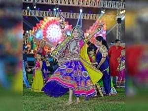 A woman in traditional attire performs garba on 8th day of Navratri festival  in Ahmedabad