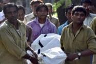 Zoo workers carry the body of a student who was killed