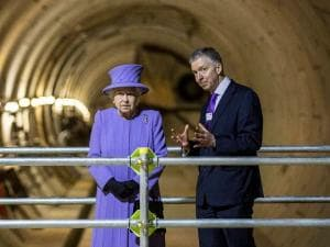 Britian's Queen Elizabeth II, centre, talks to Transport Secretary Patrick McLoughlin, left, and Mayor of London Boris Johnson, centre, during a royal visit to the construction site of the new Bond