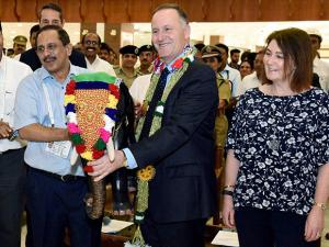 V J Kurien, MD, Cochin International Airport giving momento to Prime Minister of New Zealand John Key and his wife Bronagh