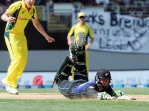 New Zealand's Martin Guptill dives in, but is run out for 90