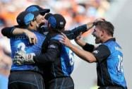 Martin Guptill,  is congratulated by teammates after taking a catch to dismiss South Africa's Rilee Rossouw