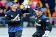 New Zealand's Luke Ronchi, right, celebrates with teammate Martin Guptill after the dismissal of West Indies Lendl Simmons