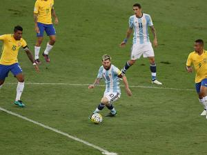 Argentina's Lionel Messi dribbles the ball during a 2018 World Cup qualifying soccer match against Brazil