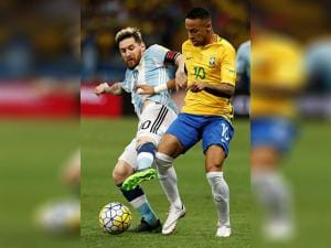 Lionel Messi and Neymar fight for the ball during a 2018 World Cup qualifying soccer match