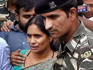 Nirbhaya's mother Asha Devi leaves after the Supreme Court confirmed death sentence for the four convicts