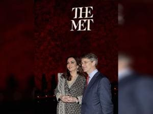 Nita Ambani, Founder and Chairperson, Reliance Foundation, receiving the Honoree's trophy for her efforts in Philanthropy from Tom Campbell, CEO & Director, The Metropolitan Museum of Art
