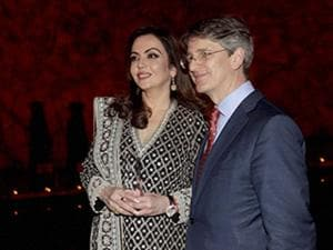 Nita Ambani receiving the Honoree's trophy for her efforts in Philanthropy from Tom Campbell, CEO & Director, The Metropolitan Museum of Art