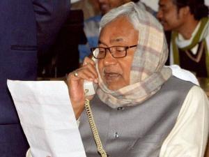 Bihar Chief Minister Nitish Kumar answering a phone call during the Janata Ka Darbar programme in Patna