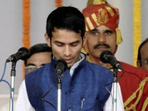 RJD chief Lalu Prasad's son Tej Pratap takes oath as a minister during the swearing-in ceremony