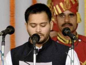 RJD chief Lalu Prasad's son Tejashwi Yadav takes oath as a minister during the swearing-in ceremony