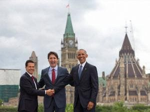 President Barack Obama, Canadian Prime Minister Justin Trudeau and Mexican President Enrique Pena Neito stand in front of Parliament Hill