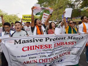 Members of Arun Chetna Manch shout slogans during a protest march