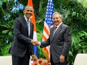 President Barack Obama shakes hands with Cuban President Raul Castro shake during their meeting at the Palace of the Revolution