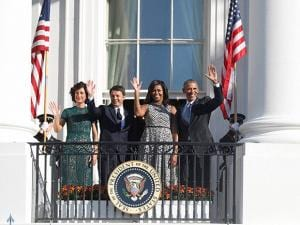 President Barack Obama, Italian Prime Minister Matteo Renzi his wife Agnese Landini and first lady Michelle Obama, wave from the Truman Balcony of the White House