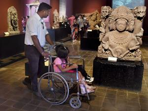 A tourist looks at a statue inside the Chhatrapati Shivaji Maharaj Vastu Sangrahalaya