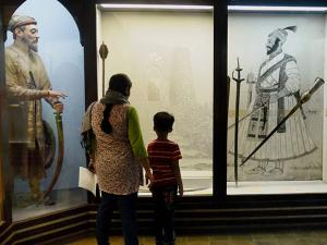A woman and her son look at the swords on display inside the Chhatrapati Shivaji Maharaj Vastu Sangrahalaya