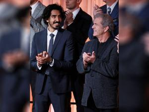 Dev Patel and Mel Gibson attend the 89th Academy Awards Nominees Luncheon
