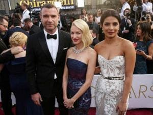 Liev Schreiber, from left, Naomi Watts, and Priyanka Chopra arrive at the Oscars