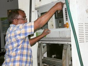 An STF official inspects a petrol pump